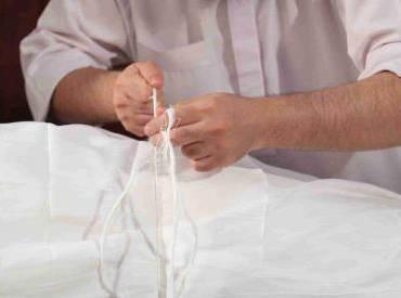 AL-KAFAN (SHROUDING)